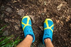 Trail runner looking down at sports shoe, running in nature royalty free stock photography