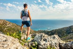 Trail runner looking at inspiring landscape Royalty Free Stock Image