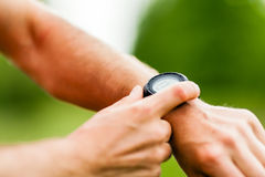 Trail runner looking at sport watch Stock Image
