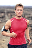 Trail runner man listening to smartphone music Stock Images