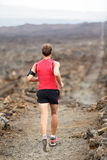 Trail runner man running cross-country run Stock Image