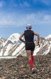 Trail runner, man and success in mountains. Running, sports. Fitness and healthy lifestyle outdoors in summer nature Stock Images