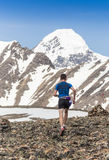 Trail runner, man and success in mountains. Running, sports. Fitness and healthy lifestyle outdoors in summer nature Royalty Free Stock Photos
