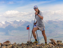 Trail runner, man and success in mountains. Running, sports. Fitness and healthy lifestyle outdoors in summer nature Royalty Free Stock Photography