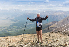 Trail runner, man and success in mountains. Running, sports. Fitness and healthy lifestyle outdoors in summer nature Royalty Free Stock Images