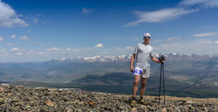 Trail runner, man and success in mountains. Running, sports. Fitness and healthy lifestyle outdoors in summer nature Stock Photo