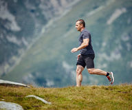 Trail runner in the mountains Royalty Free Stock Photos