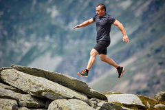 Trail runner in the mountains Stock Images