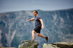 Trail runner in the mountains Stock Image