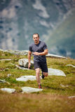 Trail runner in the mountains Royalty Free Stock Images