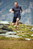 Trail runner in the mountains Stock Photo