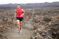 Trail runner - running man. Trail runner cross country training outdoors for marathon or triathlon. Male athlete working out on Hawaii, Big Island, USA Stock Photography