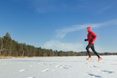 Trail runner sportsman in winter outdoor Royalty Free Stock Image