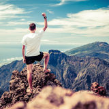 Trail runner success, man running in mountains Stock Photos