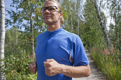 Trail runner in summer Stock Photo