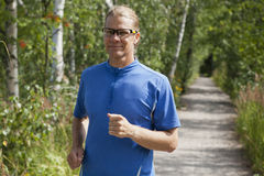 Trail runner in summer Royalty Free Stock Images