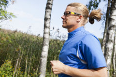 Trail runner in summer Stock Photos