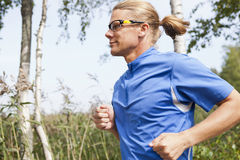 Trail runner in summer Stock Images