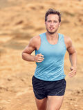 Trail runner training cardio running on mountain Stock Images