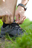 Trail runner tying shoe, running concept Royalty Free Stock Images
