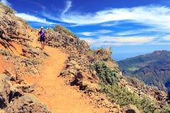 Trail runner woman, walking in mountains Royalty Free Stock Image