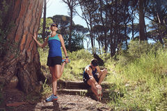 Trail runners stretching Stock Photo