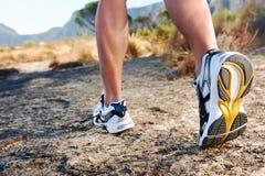 Man feet running stock image