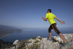 Trail running athlete man training for fitness Stock Images