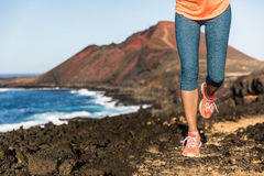Trail running athlete woman runner legs and shoes. Lower body. Fitness woman jogging living active lifestyle jogging on rocky path in mountain nature landscape stock images