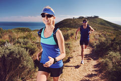 Trail running couple Stock Photo