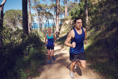 Trail running couple Royalty Free Stock Photos
