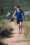 Trail running couple Stock Images