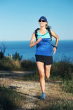 Trail running girl Stock Photos