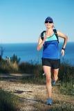 Trail running girl Stock Image