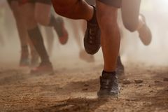 Trail running group on mountain path. Exercising,freeze action closeup of running shoes in action stock photos