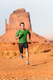 Trail running man - male runner in Monument Valley. Trail running man. Male runner in Monument Valley sprinting fast training for success. Fit sports fitness Stock Photography
