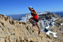 Trail Running Man on Mountain Stock Photos
