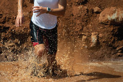 Trail running man. In the muddy terrain Royalty Free Stock Photo