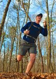 Trail Running. A man trail running out in nature Royalty Free Stock Photography