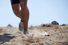 Trail running man Stock Images