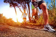 Healthy trail running. Trail running marathon athlete outdoors sunrise couple training for fitness and healthy lifestyle Stock Image
