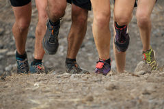 Trail running marathon. Fitness feet on rock fitness and healthy royalty free stock photos