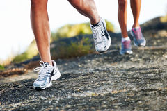 Feet running outdoor Stock Images