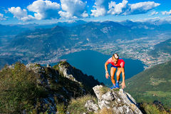Trail running in the mountains woman gets workout on the rocks a Royalty Free Stock Image
