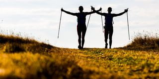 Trail running. Silhouettes of two men during morning trail tun Stock Photography