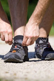 Trail running and sport shoes, tying a shoe Stock Photography