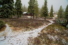 A trail in a rural winter mountain farm Royalty Free Stock Photo