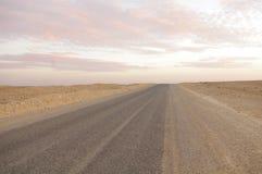 Trail of the Sahara. Track Tunisian Sahara in a sea of sand Stock Photos
