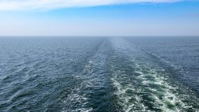 Trail in the sea from cruise ship. royalty free stock images