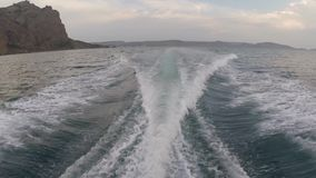 Trail on sea surface behind fast moving motor boat. Trail on sea surface behind fast motor boat clip stock video